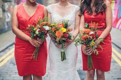 Image by Caro Hutchings Photography - A Colourful City London Wedding At The West Reservoir Centre With Red Bridesmaid Dresses And A Handpicked Bright Bouquet Photographed By Caro Hutchings.
