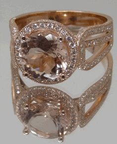 I love the colors and this is exactly what I think of but I do not like the style at all. Morganite and rose gold engagement ring.