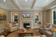 something about a fireplace flanked by windows and sofas...plus the ceiling and recessed lights...