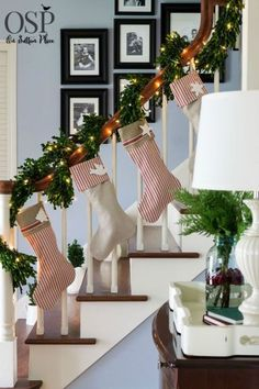 From your banister, that is. Twinkling lights woven throughout the garland make for an even prettier display for this bloggers' stockings.