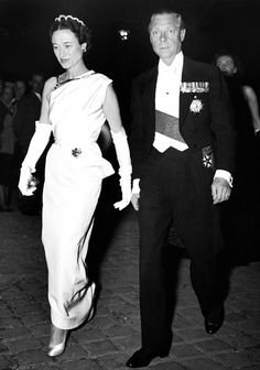 The Duke and Duchess of Windsor. The emerald bead and diamond tiara was later exchanged with Harry Winston for a huge pearshaped emerald which Wallis wore on a necklace made with the five emeralds from the flower brooch (at  her waist) and a dismantled diamond snake necklace.