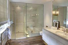 bathrooms - glass shower enclosure, hardwood floors, white floating vanity, marble counter