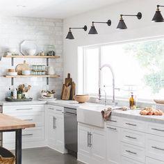 White kitchen with concrete flooring