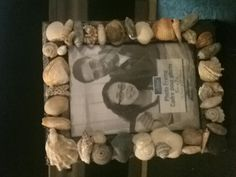 Seashell frame  What to do with all those shells from the beach and a dollar frame.