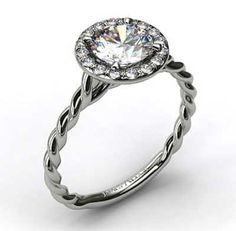 Diamond Halo Engagement Ring with Twisted Band | bridesandrings.com