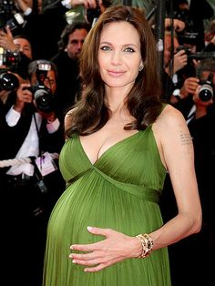 GO WITH THE GLOW  Though she hardly needed any extra sparkle at the 2008 Cannes Film Festival, the pregnant-with-twins star revved up her moss-green gown with yellow-gold-and-diamond Bulgari jewels.