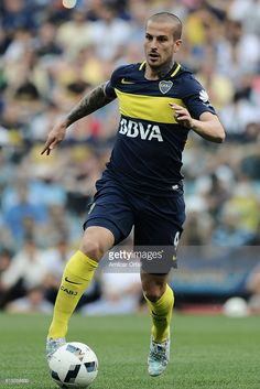 Dario Benedetto of Boca Juniors drives the ball during a match between Boca Juniors and Sarmiento as part of Torneo Primera Division 2016/17 at Alberto J. Armando Stadium on October 16, 2016 in Buenos Aires, Argentina.