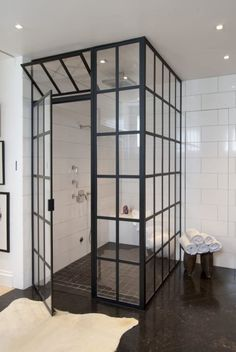 In most bathrooms, the shower enclosure is a bit of an afterthought, just a practical solution for keeping water from spraying all over the room. But lately a different kind of shower enclosure is picking up steam — steel framed doors that make the shower Beautiful Bathrooms, Modern Bathroom, Master Bathroom, Minimalist Bathroom, Master Baths, Steam Bathroom, Brown Bathroom, Chic Bathrooms, Contemporary Bathrooms