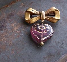 Wine Dahlia.... vintage bow and heart brooch....