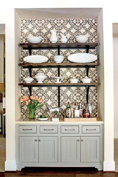 Open Shelving - Best New Kitchen - Southernliving. The first accessory selected for the space was a collection of antique ironstone china. The pieces are displayed on rustic, wooden open shelves supported by extra-long iron brackets.