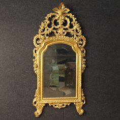 Italian mirror made by carved and golden wood 20th century. Visit our website www.parino.it