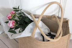 Freshly plucked pink and white flowers in a linen tote bag.