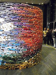 Tom Bendtsen - Over 12,000 volumes of books stacked into an oval 4 metres thick and 4 metres tall make up Bendtsen's installation Conversation #2.