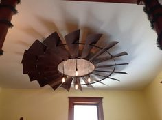 This is an antique windmill that is 8 ft across with a barn board center and Edison light bulbs we hung from our dining room ceiling.  Damn, my hubby's handy.
