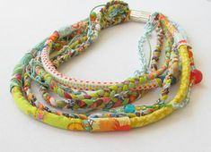 multistrand necklace colourful fabric braided into a by ATLIART, $150.00