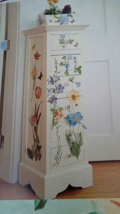 Tall drawers with floral decoupage.
