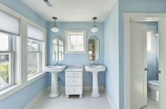 I really like this bathroom (sinks, middle counter, lights. color. windows, mirror)