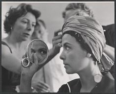 Lena Horne trying on a turban.  Source:  The Friedman-Abeles Collection, Billy Rose Theatre Division, The New York Public Library.