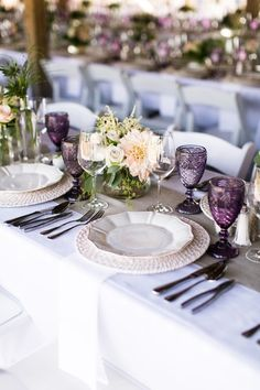 elegant wedding place setting idea burlap table runner with purple glassware and flower centerpiece