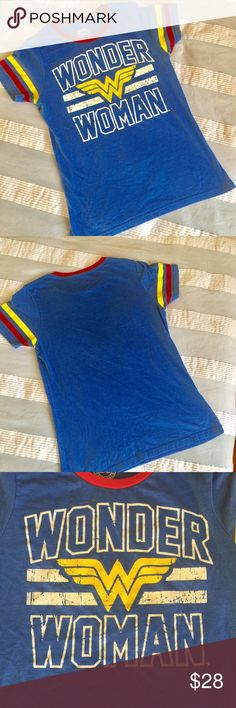 """Wonder Woman DC Comics colorful T-shirt Cute and soft Wonder Woman T-shirt. Blue with colorful writing and striped. Just in time for the Wonder Woman movie.  Size large.  Approximate measurements 17"""" armpit to armpit, 25 length. DC Comics Tops Tees - Short Sleeve"""