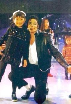 Michael Jackson during the HIStory Tour ;) He always loved babies and all children of the world ღ  https://pt.pinterest.com/carlamartinsmj/