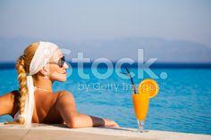 Beautiful woman resting in swimming pool royalty-free stock photo