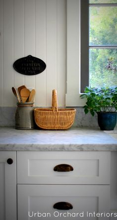 Such a beautiful kitchen reno by Urban Orchard Interiors - my Mom has a basket just like this one.