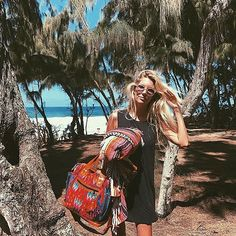 Wishing we were at the beach like this mega babe is. @the_salty_blonde looking good with one of our Vintage Day Bag ll's. #nenaandco