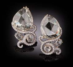 Carnet 'Amphora' Fancy Light Yellow and White Diamond earrings set in Platinum and 18K Yellow Gold