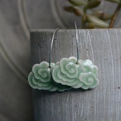 Dragon clouds in celadon green gloss porcelain.