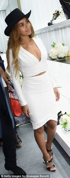 Beyonce in tight white plunging outfit at Giuseppe Zanotti store opening | Daily Mail Online