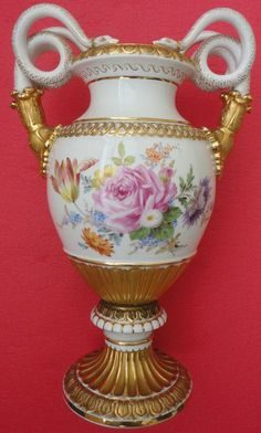 Splendid hand coloured and gilt with 18K gold Meissen vase with great snake handles, Germany1860-1924