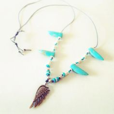 Boho style turquoise tusk necklace with silver wing charm by MideltonStudioDesign on Etsy