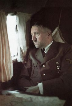 The Banality of Evil: An original color image of Hitler on his personal airplane, by Walter Frentz. His first plane was a Junkers Ju-52/3m. In 1939, his personal pilot, Hans Baur, ordered a newly-designed Focke-Wulf Fw-200 Condor, a four-engine model originally configured as a Lufthansa 26-passenger transport. It served Hitler until it was destroyed in an Allied bombing raid on July 18, 1944, two days before the assassination attempt on Hitler's life at his Wolf's Lair compound in East…