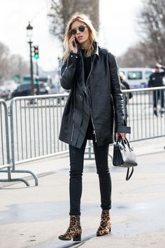 Model Anja Rubik was spotted in an off-duty look with a long leather jacket and skinny jeans that we can't wait to recreate for ourselves. The best part? She topped off her all-black outfit with a pair of cool leopard print ankle boots.