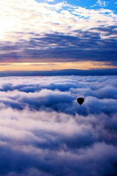 'Between Cloud Layers' - photo by Michael Slezak (ms4jah), via Flickr