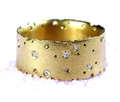 Precious' Ring in 18ct gold with diamonds  Kate Smith's ring is from her 'Patterned' collection where she features thousands of tiny holes in silver and gold to create the effect of decay.