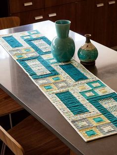 "easy modern table runner, 12 x 54"", by Mary McGuire at Fons  Porter.  It looks great on this metal table."