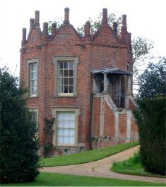 """Banqueting house in the garden of Melford Hall, Suffolk - The Benedictine abbey at Bury St Edmunds owned the manor of Melford even before 1066. It was Henry VIII's dissolution of the monasteries that placed it in private hands by 1547.  In 1578 Queen Elizabeth was a guest."""