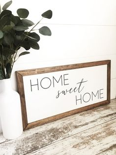 Home Sweet Home. This handmade wood sign is the perfect addition to any farmhouse decor. This can either be displayed on a wall, or can sit upright on its own. Makes the perfect housewarming gift! Click to shop more signs for the home! #charlieandpine #homedecor #woodsigns #homesweethome #farmhouse #livingroomdecor #farmhousestyle #farmhousedecor