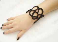 Black crochet bracelet.... $15.90, via Etsy.