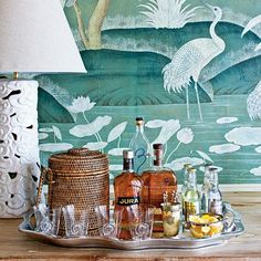 Stock a Proper Bar - Foolproof Formulas for Home Decorating - Southernliving. Stock the bar in style with Phoebe's easy bar formula. Learn How To Stock the Bar Bandeja Bar, Tapete Gold, Soirée Halloween, Bar Tray, Trays, Drinks Tray, Beverages, Drinks Trolley, Bar Cart Styling