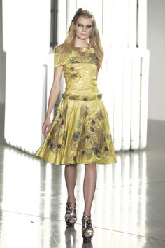 Rodarte Van Gogh collection again. I love the collection but i'll pass on that eye makeup... looks like she got punched lol