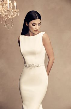 7ad99e35ebd2 Sleeveless Paloma Satin gown with boat neckline and beaded appliqué along  V-back neckline. Fabric belt with beaded appliqué at waist. Fit and flare  skirt.