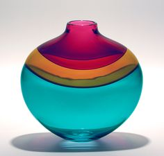 Flat Banded Vase: Blue by Michael Trimpol and Monique LaJeunesse. Bands of rich color drape the shoulder of this *blown:blown glass* *incalmo* glass. Signed on bottom.