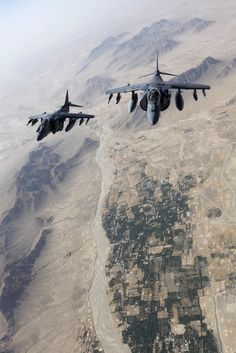 AV-8B Harrier jets with Marine Attack Squadron 311 fly over Helmand province…
