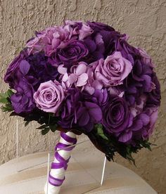 Lavender roses and deep purple hydrangeas. Beautiful.