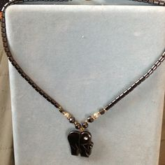 """Hematite Elephant Necklace J17 Nice Hematite elephant necklace with faux pearl and CZ trim. Gold-tone accent.  Measures 18"""" and in very nice  condition. Jewelry Necklaces"""