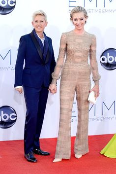 Ellen DeGeneres in a blue sapphire suit with Portia de Rossi in Valentino.