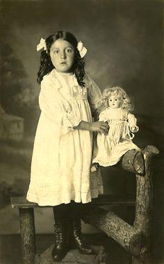 Vintage photo of girl with a doll. Sephia photos. Epherma.